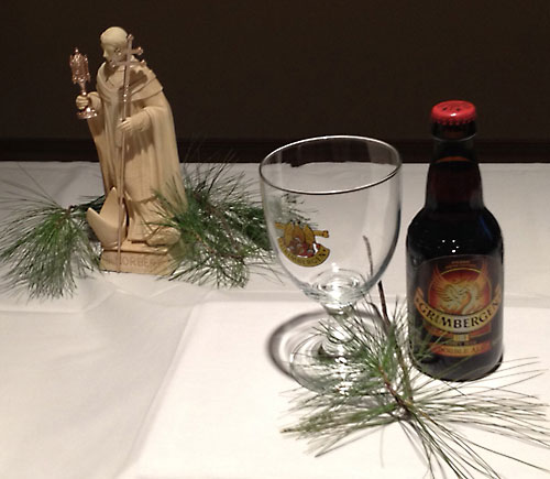 """Grimbergen Double Ale, a Norbertine abbey beer from Belgium, pictured, was one of four selections available for tasting at """"All Things Norbertine! History, Music, Abbey Ale,"""" Jan. 30 at the Norbertine Center for Spirituality, St. Norbert Abbey, De Pere. Bottles of the four beers were featured on a display table along with labeled glasses and a small statue of St. Norbert. The history of Norbertine beer dates back to the Middle Ages. (Jeff Kurowski   The Compass)"""