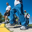 "Members of Resurrection Parish participate in ""The Journey, Walking the Road to Bethlehem"" Sept. 14. (Sam Lucero 