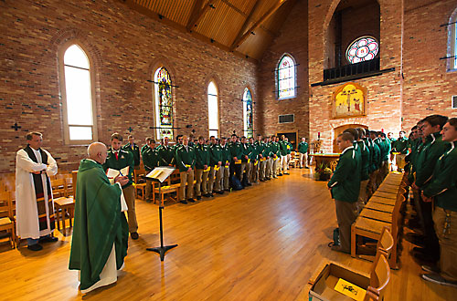 Norbertine Fr. Andrew Ciferni reads the Gospel at the St. Norbert College football team Mass, Sept. 13, at Old St. Joseph Church on the De Pere campus. Defensive lineman Stuart Kwaterski holds the book of Gospels. Concelebrating is Norbertine Fr. Jay Fostner, left. Coach Steve Opgenorth led an initiative to have the team gather for Mass as part of home pregame preparations. (Mike Roemer | Courtesy of St. Norbert College)