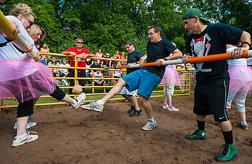 Diocesan employees participate in a game of human foosball during the St. Patrick Parish summer festival Aug. 9 in Stephensville. Pictured from left are Deborah Wegner-Hohensee, parish planning director; Cindy Dorn, a St. Patrick parishioner; Fr. Dan Felton, vicar general; Deacon Peter Gard, international priest coordinator; and Mark Mogilka, stewardship and pastoral services director. (Sam Lucero | The Compass)
