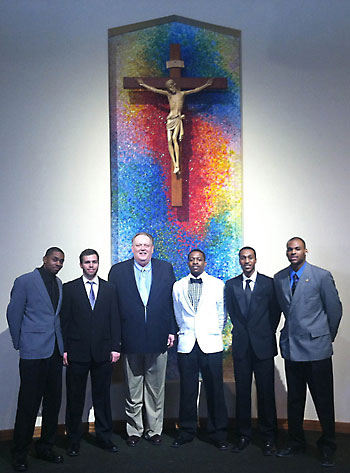 Members of the Silver Lake College basketball team are pictured inside St. John's of Rochester Church in Fairport, N.Y. Pictured are Austin Allen-Walker, left, Derek Domino, Coach Phil Budervic, Chris Jones, Aaron Davis and Darius Barnes. (Photo Courtesy of Silver Lake College of the Holy Family   For The Compass)